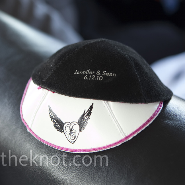 Sean wore a white leather and pink stitched yarmulke with the couple's winged heart logo, and guests wore black suede ones.