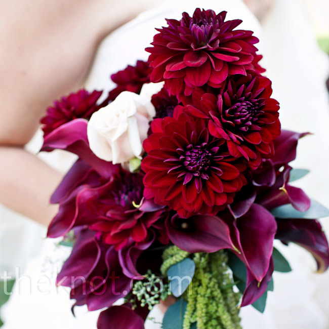 Danielle carried a cascading bouquet of dark-fuchsia dahlias and calla lilies.