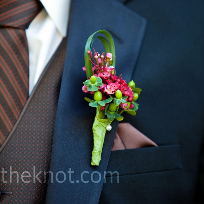 An array of hot pink blooms and berries popped against Brian's navy lapel.