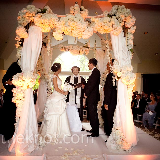 The Bombay-style huppah was draped with fabric, hydrangeas and roses. It was set in the center of the room so guests could sit in a circle around the couple.