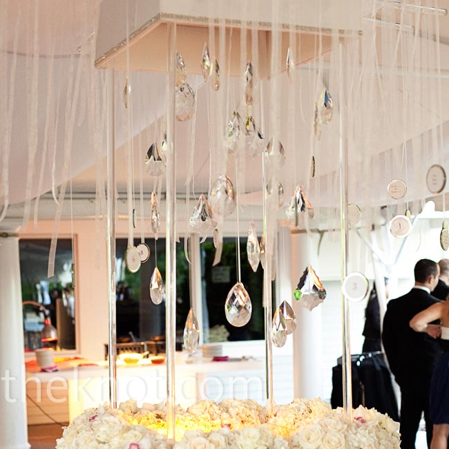 Guests' names and table numbers were written onto mirrors and hung within this jaw-dropping display of ribbons, crystals, candles and roses.