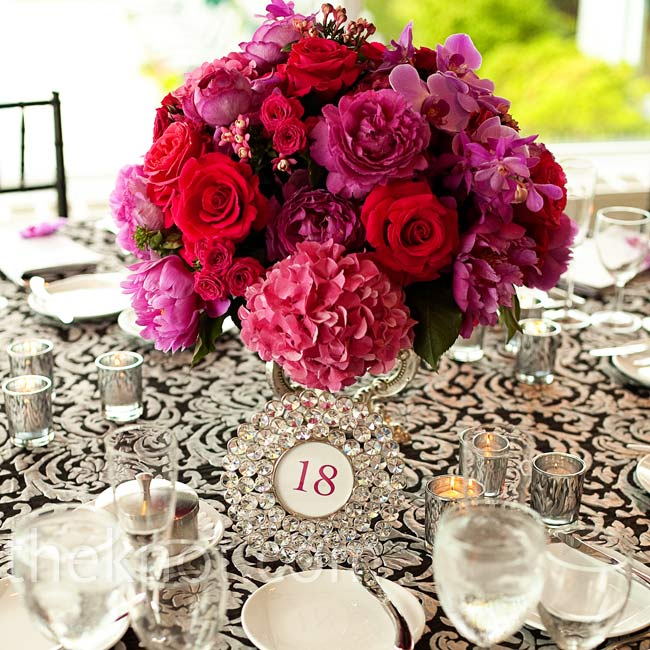 To appease both Brooke's and Michael's different styles, the centerpieces alternated between low, lush arrangements and more opulent ones.