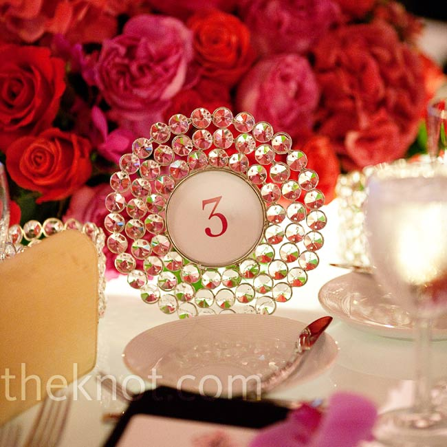 The table numbers were set in ornate glass frames.