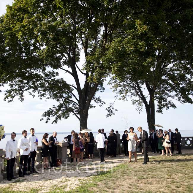 Guests had a blast during the wedding, exploring the castle and taking in the amazing view of Long Island Sound from the lawn.