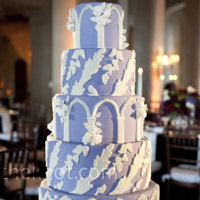 This purple cake, with white arches and castle-inspired details, fit the theme.