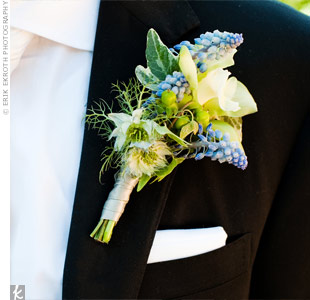 Greg wore a classic white tie and a boutonniere of muscari, freesias and ivy for an organic look.