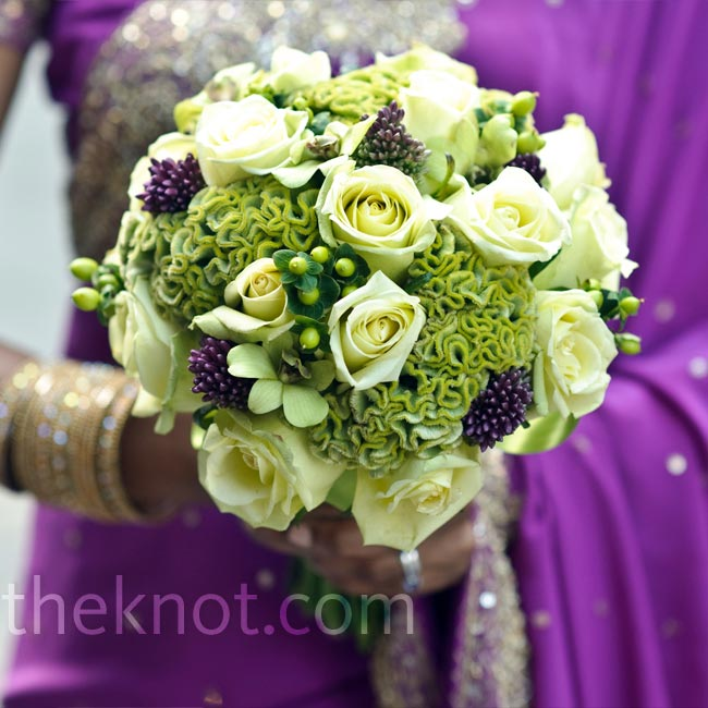 The bridesmaids carried textured bouquets of roses, celosia and berries.