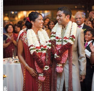 For the reception, Mirna changed into a red lehenga with beading and chiffon draping.