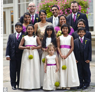 The entire bridal party wore magenta accents, including the flower girls, who had colored sashes wrapped around their white dresses.