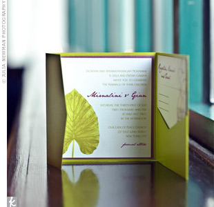 A tri-fold invitation suite showcased the couple's wedding motif: a palm leaf design with magenta text.