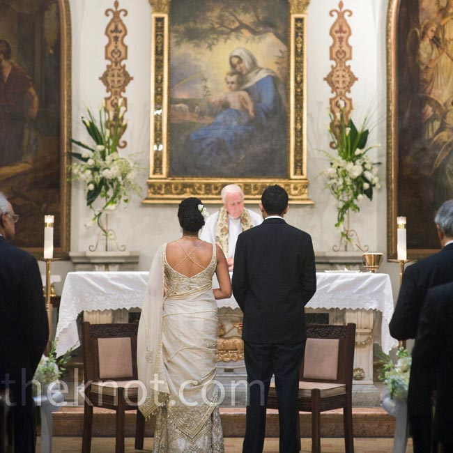 Mirna and Gian chose Our Lady of Peace for its already beautiful décor of murals and chandeliers. They added simple floral arrangements to the altar.