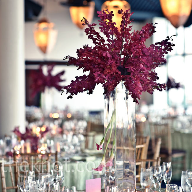 Magenta orchids jutting out from tall glass vases added drama to the space.