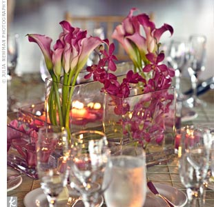 Some dinner tables were topped with short vases filled with calla lilies, orchids and floating votives for a minimalist look.