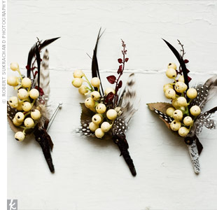 The groomsmen wore boutonnieres with guinea feathers and cream berries. Elis was wrapped in lace.