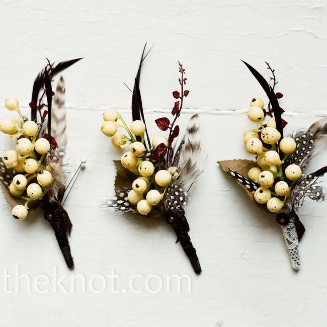 The groomsmen wore boutonnieres with guinea feathers and cream berries. Eli's was wrapped in lace.