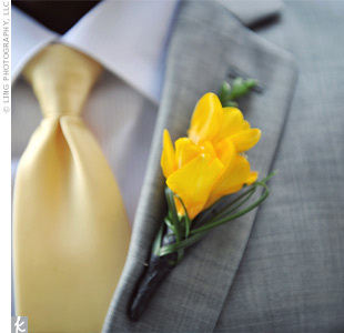 A few sprigs of yellow freesia coordinated nicely with Drews yellow tie.