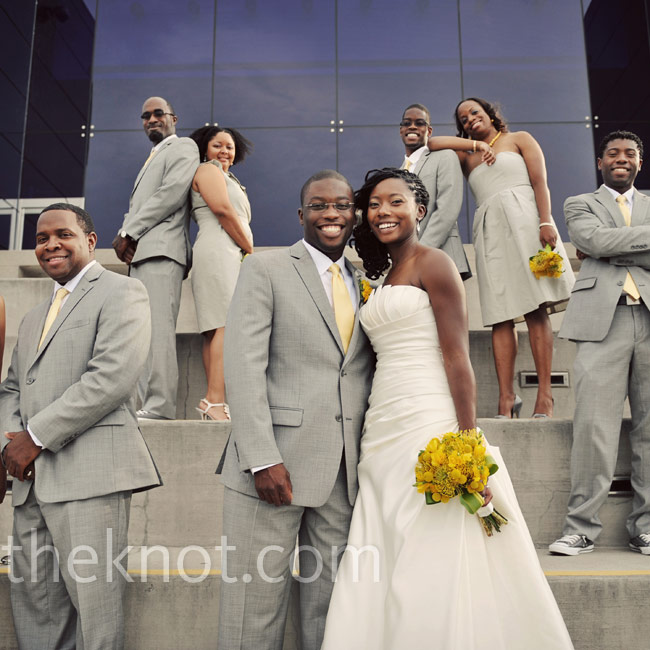 Each bridesmaid chose her favorite dress from J. Crew in a flattering pewter color. The groomsmen's gray suits, Converse All-Stars and yellow ties kept their look in step with the celebration's color palette.