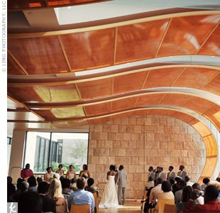 The stunning architecture of Bigelow Chapel was exactly what the couple had in mind for their ceremony. The warm amber walls felt like the building was embracing you as you entered, says Amma.