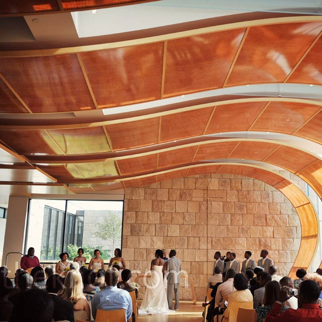 "The stunning architecture of Bigelow Chapel was exactly what the couple had in mind for their ceremony. ""The warm amber walls felt like the building was embracing you as you entered,"" says Amma."