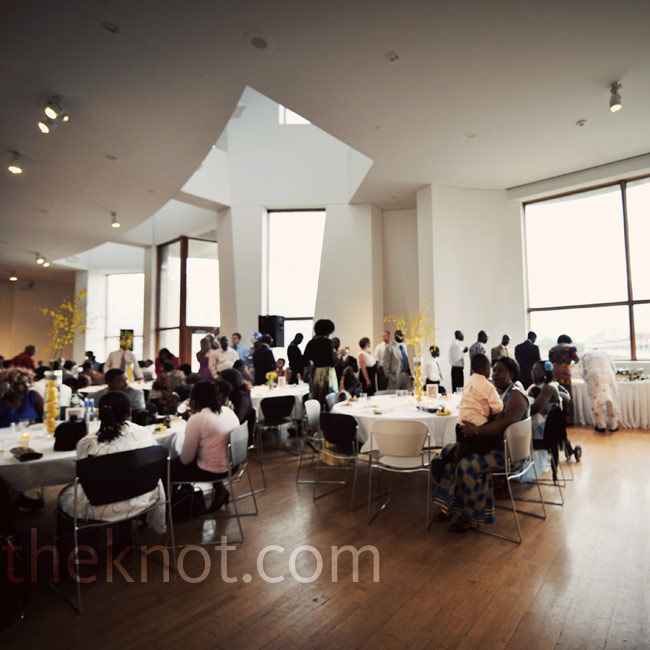 Brilliant natural light, pouring in from the museum's large windows, made the yellow centerpieces pop against the crisp white linens.