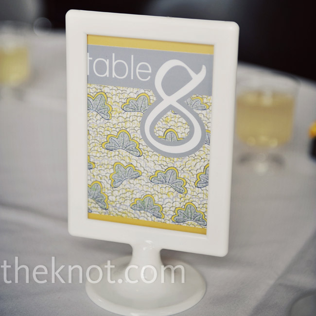 The gray and yellow table numbers coordinated nicely with the rest of the wedding stationery. The cards sat on the tables in pedestal frames.