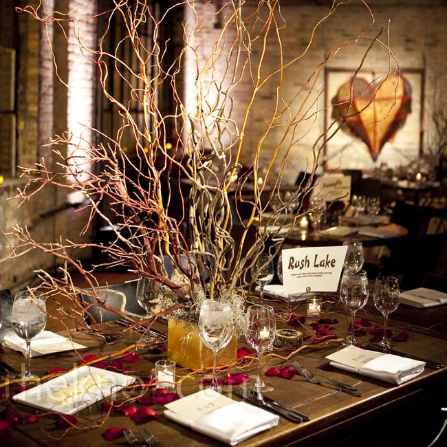 The venue had all-different styles of tables and chairs, so the couple opted for mismatched flowers as well. This rustic arrangement of tall branches decorated one of the smaller tables.