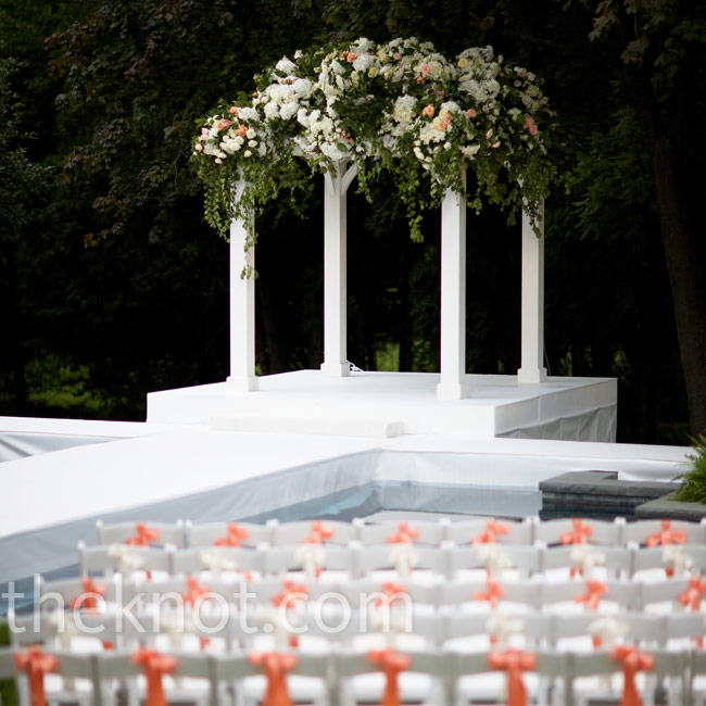 Todd added a pop of color to these guest chairs, which in turn brought out the subtle orange roses in the otherwise green and white arbor.