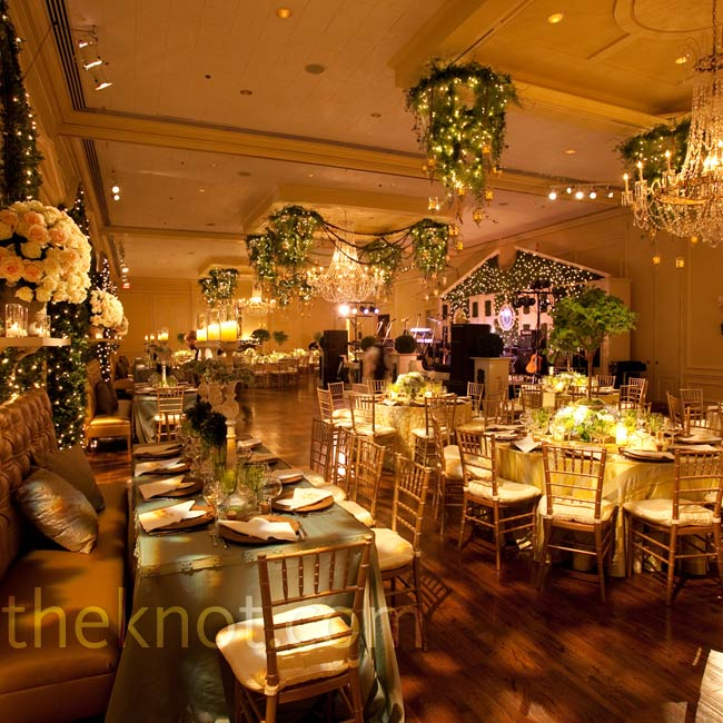 Chandeliers, draped vines and gold accents gave this reception space a warm, Secret Garden-like feel.