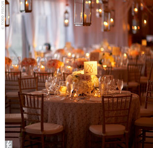 Since these reception tables featured low centerpieces, Todd filled the remaining space with hanging hurricane lanterns.