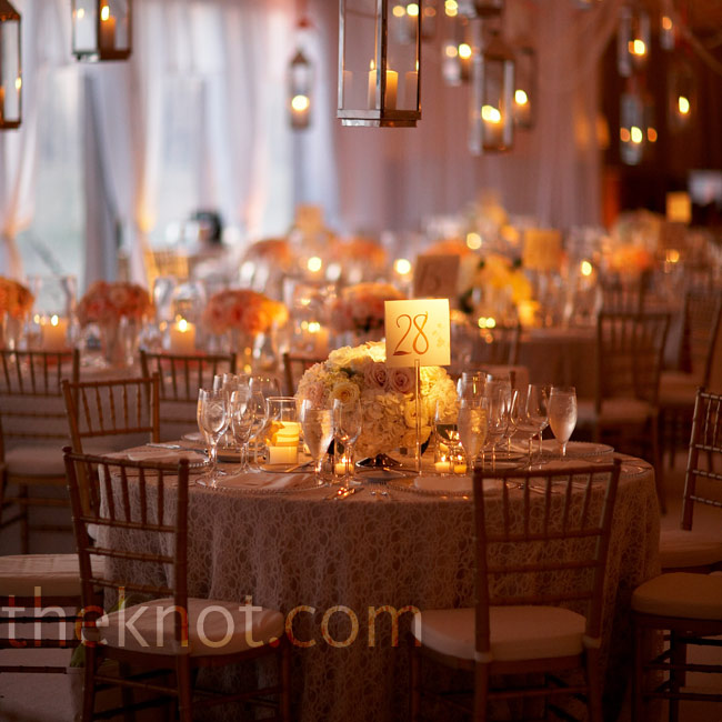 Since these reception tables featured low centerpieces, Todd filled the remaining space with hanging hurricane lanterns.  Photo: Stephen Karlisch Photography