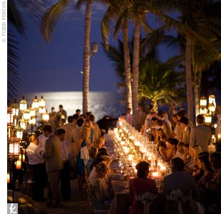 At Eli Manning's seaside reception, guests dined at long banquet tables lined with candlelit vases.