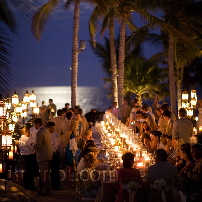 At Eli Manning's seaside reception, guests dined at long banquet tables lined with candlelit vases.  Photo: Stephen Karlisch Photography