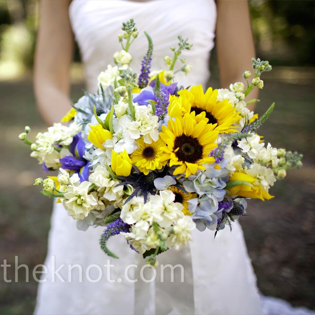 Alexandra Carried A Lush Mix Of Sunflowers, Blue