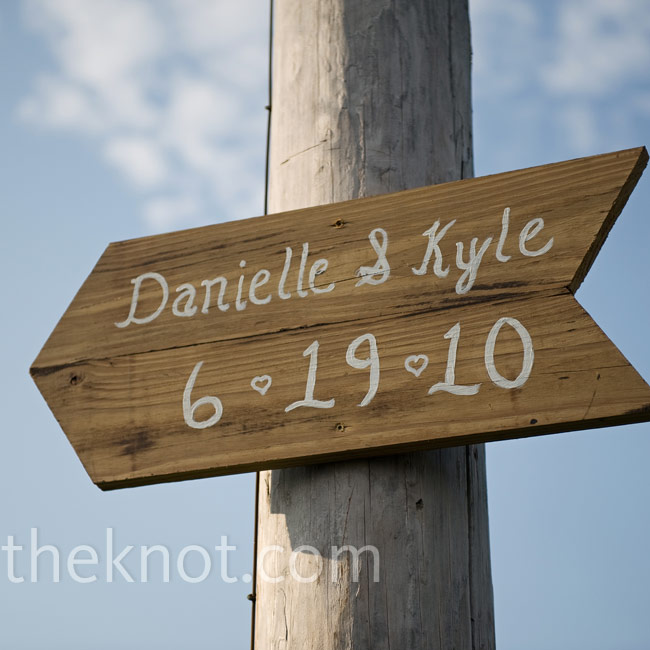 Danielle's stepfather made this sign out of reclaimed fence lumber, and her mother did the painting. Similar signs directed guests around the property.