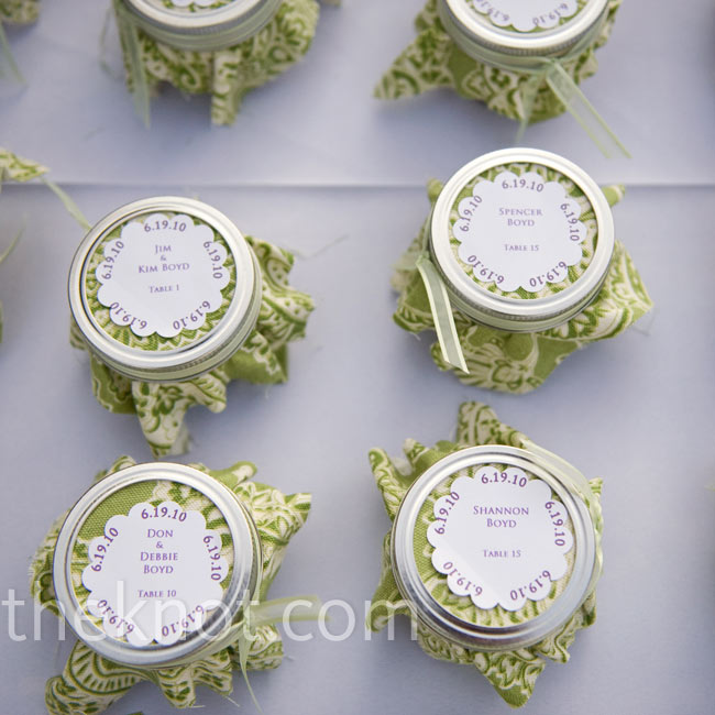 "The couple cooked up homemade grape jelly themselves for the favors. The jars doubled as escort cards, with the name of the guest, the table number, and the phrase ""Spread the love"" on each lid."
