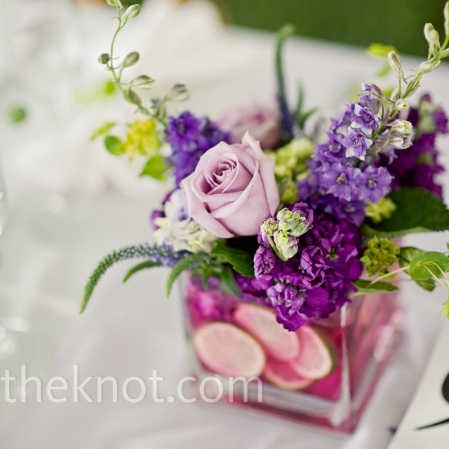The water inside the centerpiece vases turned hot pink, but not on purpose! The cut limes, when combined with the flowers, colored the water unexpectedly, but the guests were fooled -- and impressed.