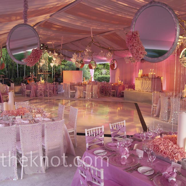Oversized mirrors, dripping crystals and alternating chair-back treatments gave depth to this tented reception's decor.