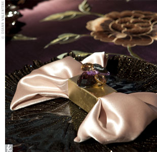 Jeweled napkin rings accented the embroidery in these rich, plum linens.