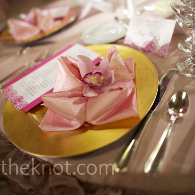 Individual blooms atop folded napkins are an elegant way to welcome guests to their seats.