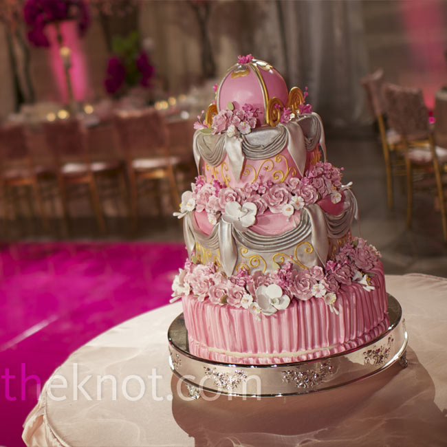 For another I Do Over wedding, Valentine commissioned a princess-inspired wedding cake of sugar flowers and fondant ribbon.
