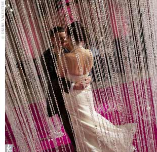 For a jaw-dropping surprise, Valentine hung a circular crystal curtain, inside which the couple shared their first dance.