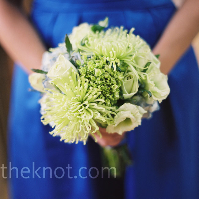 The bridesmaids carried green bouquets of hydrangeas, lisianthus, spider mums and tea roses, with some blue hydrangeas mixed in.