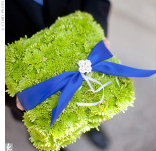 Instead of a traditional ring pillow, the ring bearer carried one made of small green button poms.