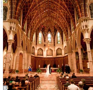 The couple said their vows inside Holy Name Cathedral, which they chose for its history and its special meaning to Gina.