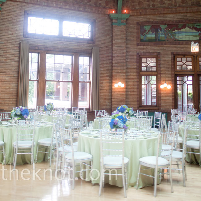 Cafe Brauer's beautiful hardwood floors, exposed-brick walls, chandeliers and outdoor terraces created the perfect mix of city and rustic. The couple kept the tables simple, with low florals and pale-green linens.