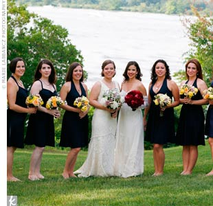 The seven bridesmaids wore navy-blue J. Crew dresses in various styles. Everyone went barefoot for the ceremony on the grass.