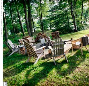 Guests hung out around this fire pit set up with Adirondack chairs.