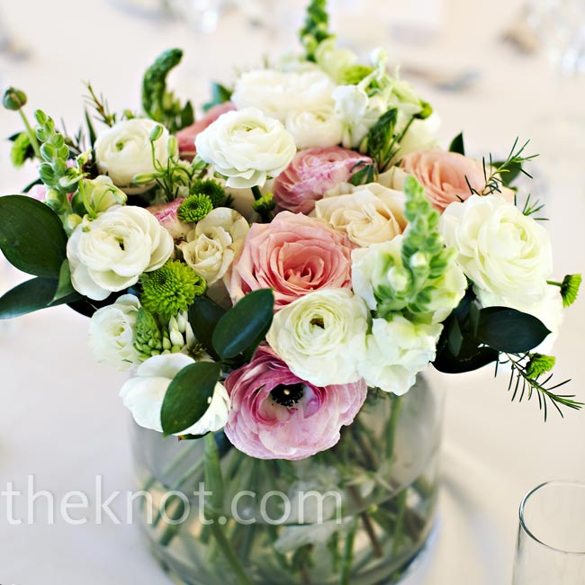 Arrangements of pale-pink and white ranunculus and roses decorated the dinner tables, alongside various glass votives.