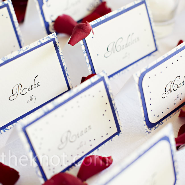 Dana printed and stamped the escort cards herself and displayed them with red rose petals.