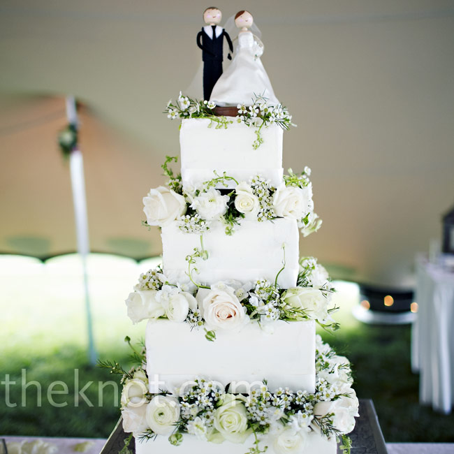 Roses and baby's breath separated the square tiers, and Johann made the topper.